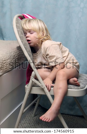 Exhausted little girl just fall asleep straight on the chair  - stock photo