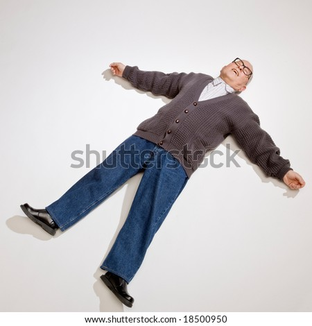 Exhausted man laying on ground with arms outstretched