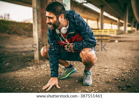 Exhausted man resting after jogging - stock photo