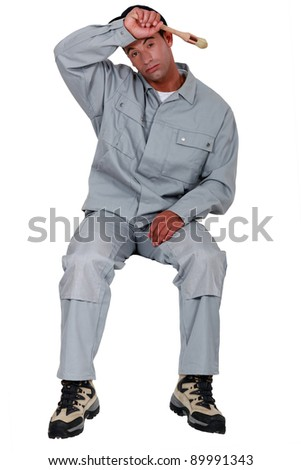 Exhausted painter - stock photo