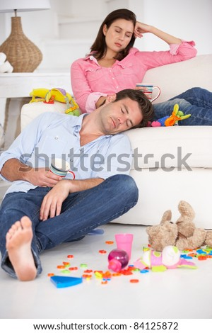 Exhausted parents resting - stock photo