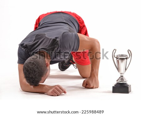 Exhausted runner after win a trophy award. tired trainer. - stock photo