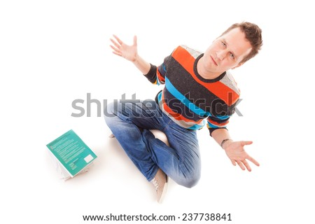 Exhausted tired college student with pile of books studying for exams isolated on white background - stock photo