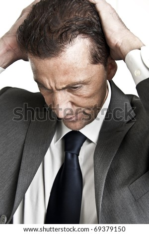 Exhausted/Worried Mature Businessman - stock photo