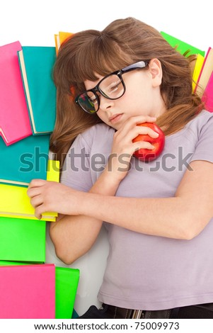 exhausted young girl sleeping on pile of books, isolated on white background - stock photo