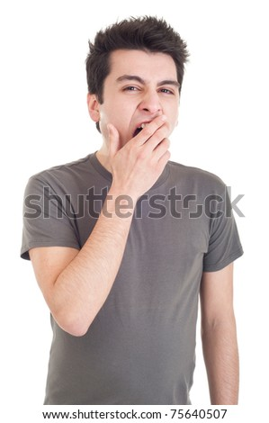 exhausted young man yawning isolated on white background - stock photo