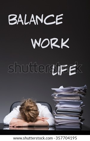 Exhausted young woman and balance work life writing - stock photo