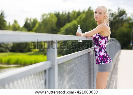 Exhausted young woman rests after stamina training - stock photo