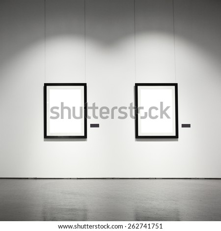 Exhibition hall with empty frames on wall - stock photo
