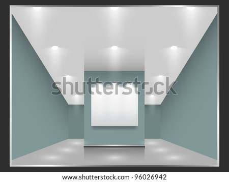 Exhibition hall with white frames on the wall, illuminated by floodlights. - stock photo
