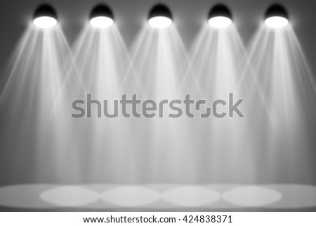 Exhibition interior with gray wall and floor and spotlight. Copy space - stock photo