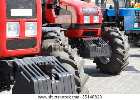 Exhibition of new tractors for agriculture and other works - stock photo