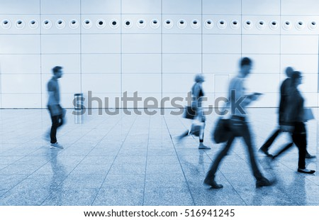 Exhibition walkway with blurred people