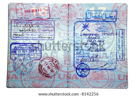 Exit and entry stamps and two Visa stamps from Oman and Qatar inside a US passport - stock photo