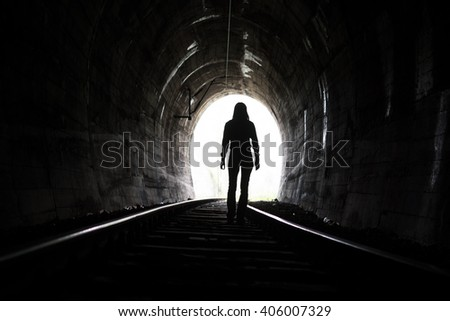 Exit from darknes - Light at end of tunnel - stock photo