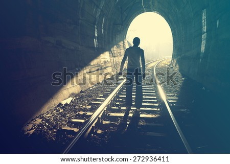 Exit from darkness - Light at end of tunnel - stock photo