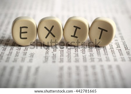 EXIT on newspaper, shallow depth of field image. - stock photo