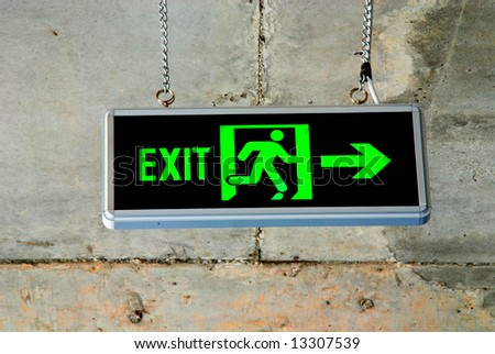 exit sign on concrete background