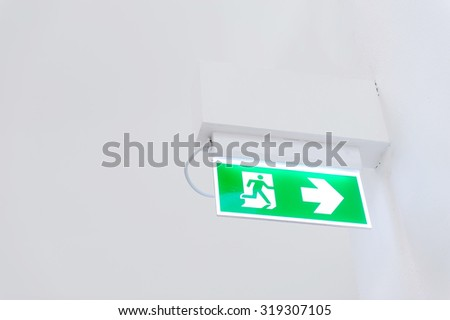 Exit sign on the wall. - stock photo