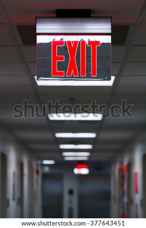 EXIT Sign Suspended Inside Of An American University College Dormitory Residence Hall Building - stock photo
