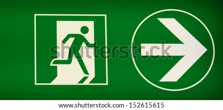 exit sign to show people the way out of a building  - stock photo