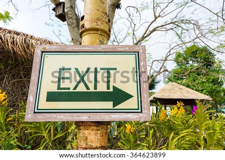 Exit Signs in garden or park - stock photo