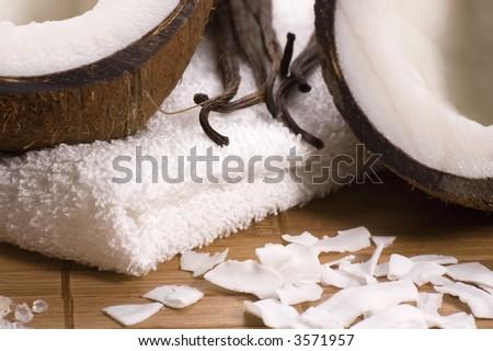 exotic bath items. coconuts, vanilla, towel, salt - stock photo