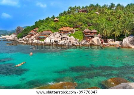 Exotic Bay with hotel villas. Cear emerald sea. - stock photo