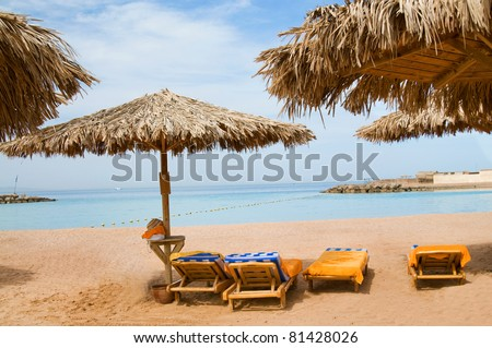 Exotic beach and gulf against blue sky. - stock photo