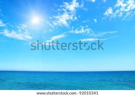 Exotic beach under a blue sky - stock photo