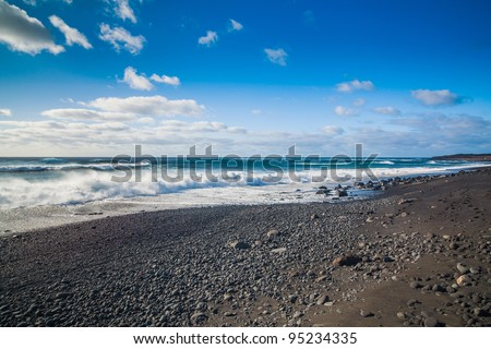 Exotic beach with black sand on Lanzarote, Canary islands, Spain - stock photo