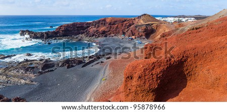 Exotic beach with black sand red rocks on Lanzarote, Canary islands, Spain. Panorama - stock photo