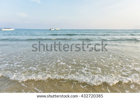Exotic beach with gentle wave and clear, Ripple wave and clear on beac with blue sky - stock photo