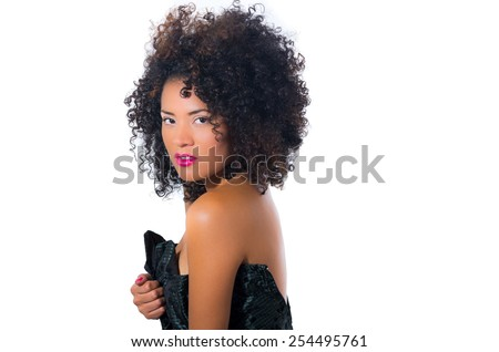 exotic beautiful young girl with dark curly hear posing isolateing on white