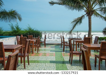 exotic cafe at ocean coast - stock photo