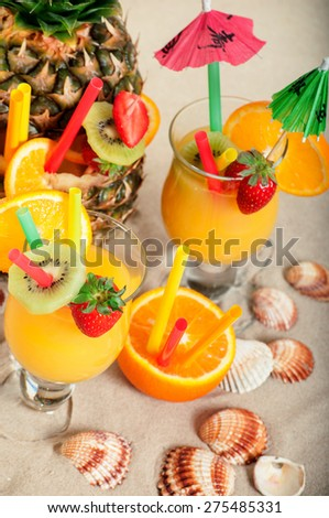 Exotic cocktail on the beach - stock photo