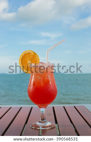Exotic cocktail summer drinks , blur beach on background