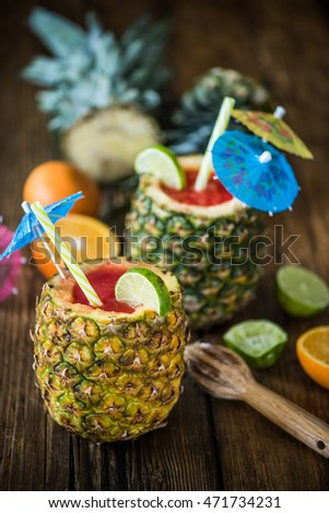 exotic coctail in pineapple, tropical fruits