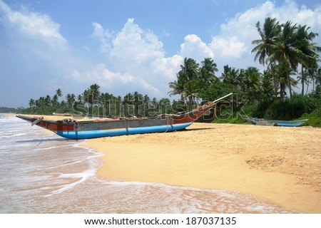 Exotic fisherman boat on beach near the ocean