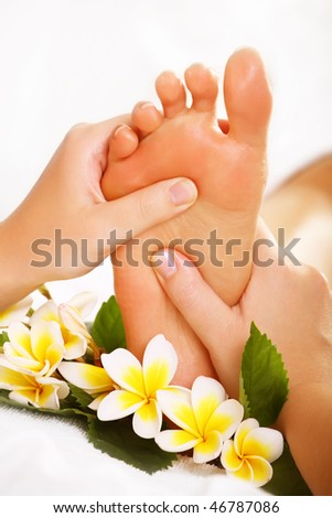 Exotic foot massage and spa foot treatment. - stock photo
