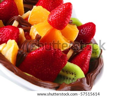 exotic fruits in chocolate cream on white bowl