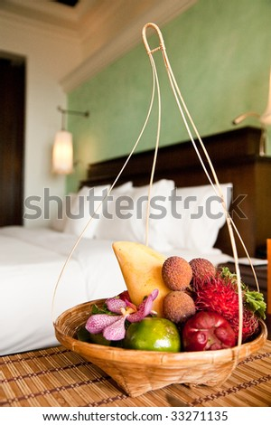 exotic fruits in the hotel room - stock photo