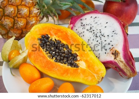 exotic fruits on a table - stock photo