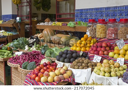 Exotic fruits on display on a market - stock photo