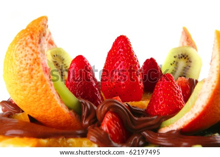 exotic fruits salad in chocolate served on white