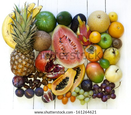 Exotic fruits variety still life on vintage wooden boards - stock photo