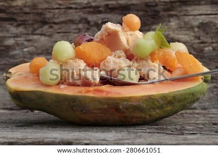 exotic fruits with papaya ice cream - stock photo