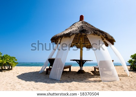 exotic hut on tropical beach - stock photo