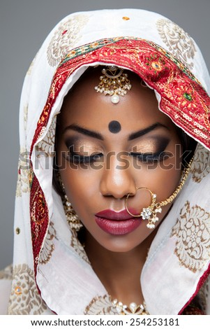 Exotic Indian bride dressed up for wedding ceremony - stock photo