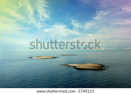 exotic islands at open sea - stock photo